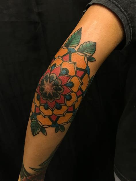 flower elbow tattoos traditional colored flower