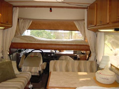 bed down motorhomes for hire with pull down beds