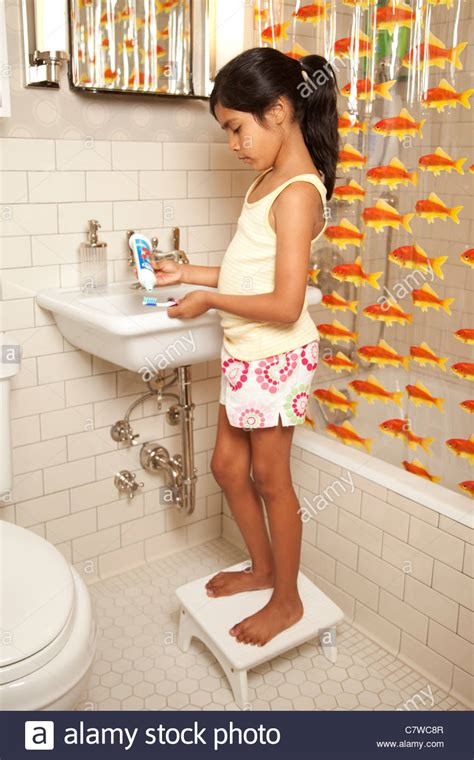 video of girl in bathroom young girl in bathroom brushing teeth stock photo royalty