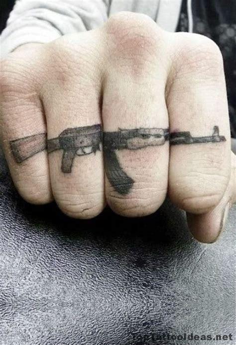 ak47 tattoo on finger ak 47 tattoo idea finger tattoos pinterest ak 47
