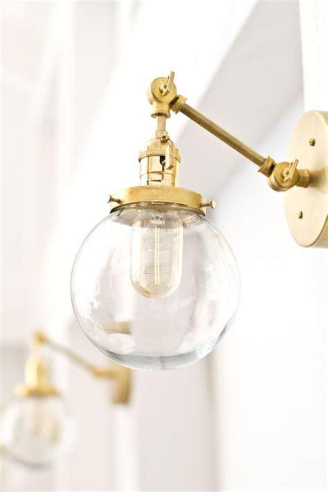 globe bathroom light fixtures make this gorgeous brass globe sconce for around 70