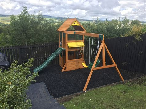 swings and climbing frames jute climbing frame with slide swings and rock wall