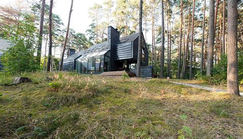 chic modern forest home in lithuania by studija archispektras