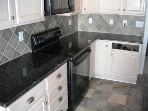 white kitchen cabinets with black granite countertops kitchen kitchen backsplash ideas black granite