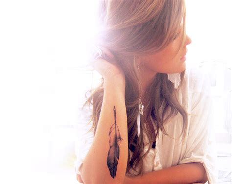 feather tattoo inner bicep arm feather sara magdalena hermansson tattoo image