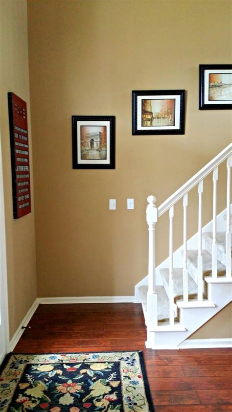 benjamin spice gold walls cherry floors white trim and black accents color