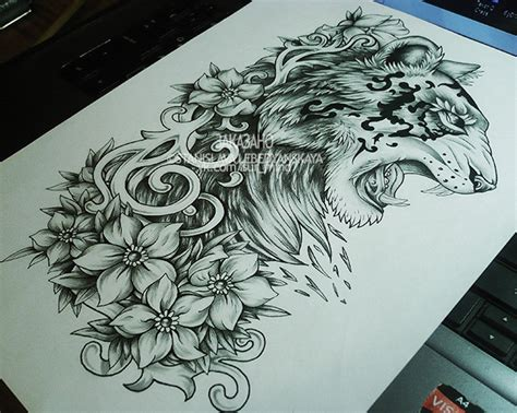 lion and flowers tattoo