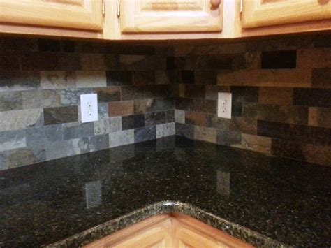 uba tuba granite countertop kitchen eclectic with