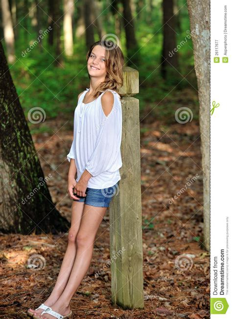 0008288607 the girl in the woods cute young girl in the woods royalty free stock