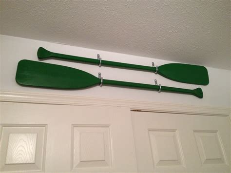 how to hang oars or paddles in an x shape the inspired oars as wall decor found these thrifting one day and