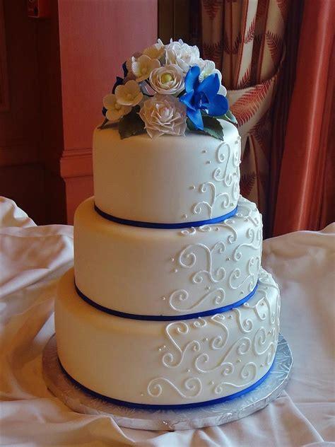 Blue Ribbon Cake Decorating white on white scrolls and royal blue ribbon cake decorating community cakes we bake