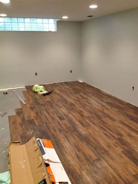 installing peel and stick laminate floors in a basement remodel by cozy cape cottage basement