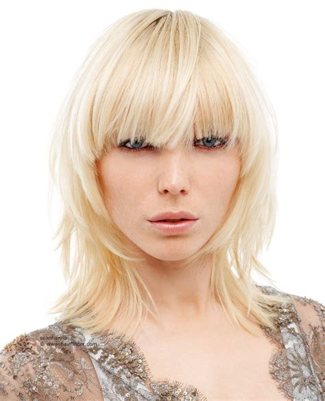 hair styles cut hair in layers and make curls or flicks shoulder length shag with short layers and blunt bangs
