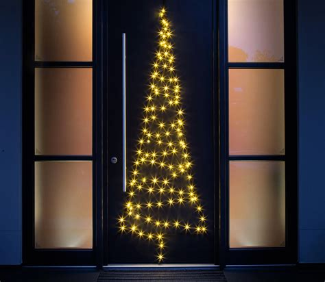 fairy bell door christmas tree lights add festive glow to