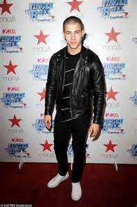 charlie puth jacket hailee steinfeld vs it up for jingle ball launch