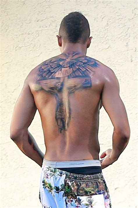 new tattoo raised up nick cannon shows off enormous tattoo of jesus which