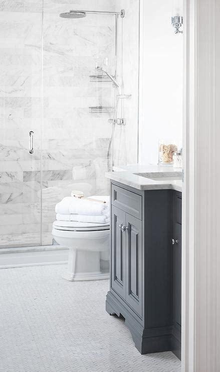 dark grey bathroom vanity dark gray washstand with marble herringbone tile floor