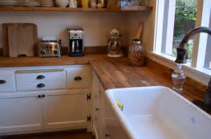 butcher block bathroom sink kitchen with apron sink facing window and butcher block