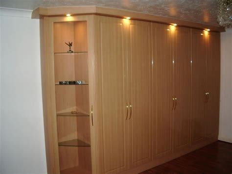 fitted wardrobe with lights and glass shelves stylish