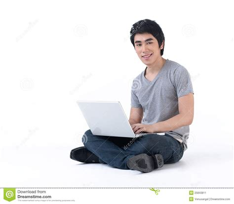 Sitting On by A Sitting On The Floor Work With Laptop Stock Image