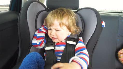 baby screams in car seat seat belt stock footage