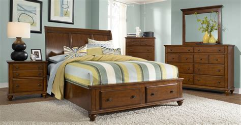 light cherry bedroom furniture hayden place light cherry sleigh storage bedroom set from