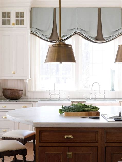 oval window treatments island with oval marble top kitchens