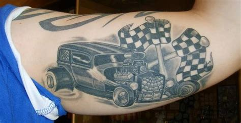 checkered flag tattoo car with checkered flags grey ink on muscles
