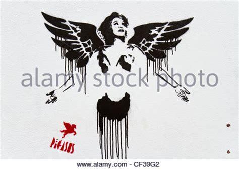 graffiti  brick lane depicting  kray twins stock
