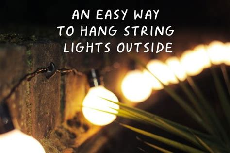 an easy way to hang string lights outside hanging
