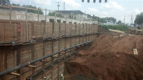 Temporary Wall by Mountain Creek Shines With Temporary Soldier Pile And