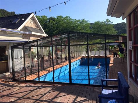 Swimming Pool Enclosures Residential | high or low pool screen enclosures which one should you