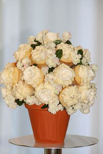 cupcake flower arrangements cupcake flower cupcake and table centerpieces on pinterest