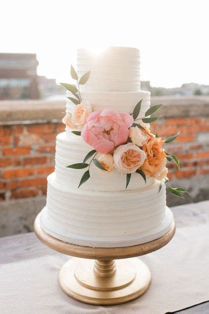 Wedding Cake Simple Flowers by Simple White Textured Cake With Beautiful Flowers Let
