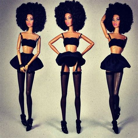 black doll on bed rocking an afro this would actually be a