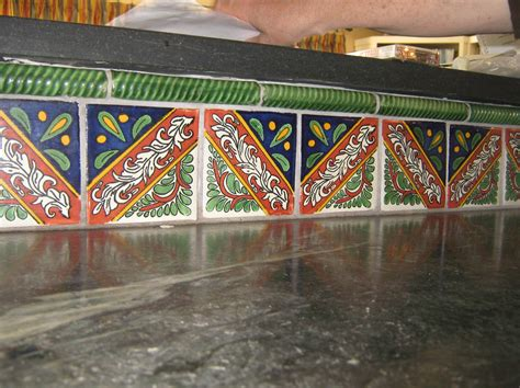 backsplash of mexican tile in a countertop mexican home