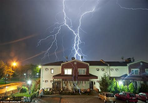 lightning hits house a perfect storm capturing the exact moment lightning strikes a suburban house daily