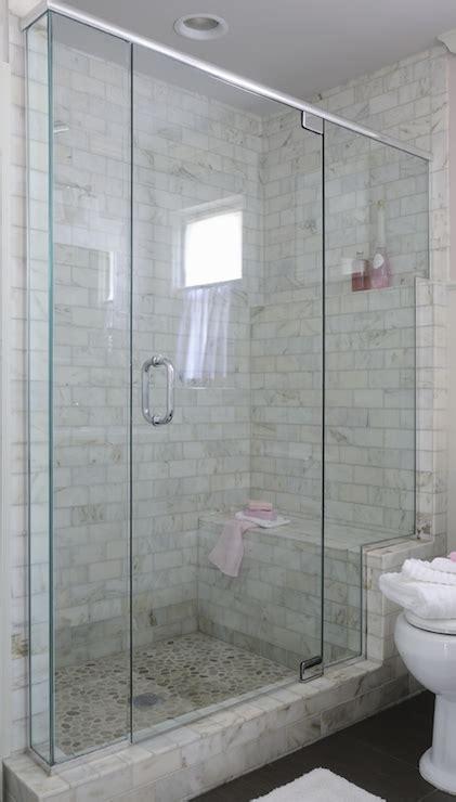 tiled walk in shower with bench pebble shower floor design ideas