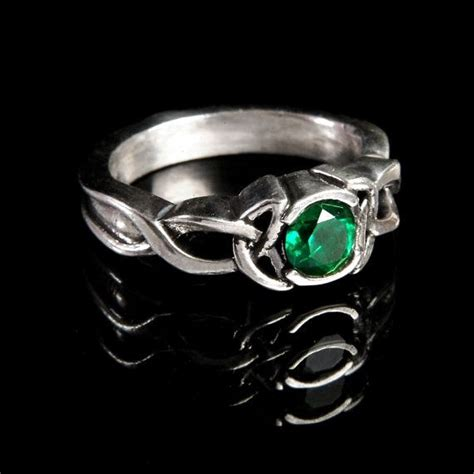 celtic emerald engagement ring with knot design in