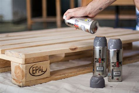 spray painting varnished wood pallet bed with spray paint novasol