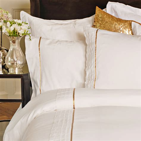 gold bedspreads and comforters white and gold bedding so chic girls district