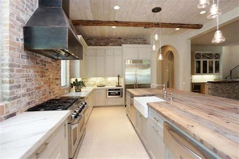 kitchen exposed brick  marble counters google search