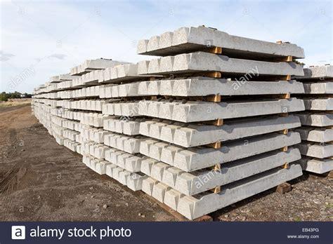 concrete railway sleepers stacked awaiting railway line