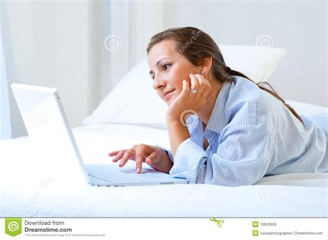 working in bed woman working on bed royalty free stock images image