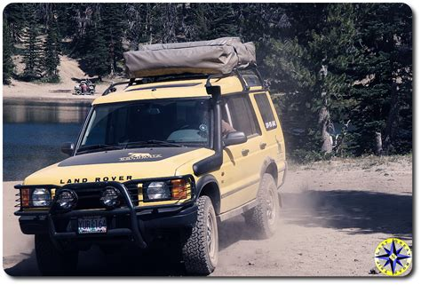 yellow land rover discovery what you should about wilderness aid road