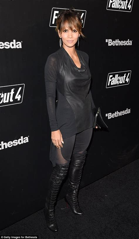 Halle Berry Gets On Knees For A by Halle Berry Sizzles In Edgy Lbd And Knee High Boots At