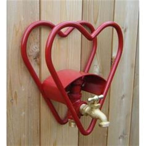 Garden Hose Hanger With Faucet by 1000 Images About Hose Holder Wrought Iron On