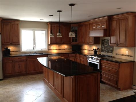 cherry wood kitchen cabinets with black granite cherry cabinets maple wood doors black granite counters