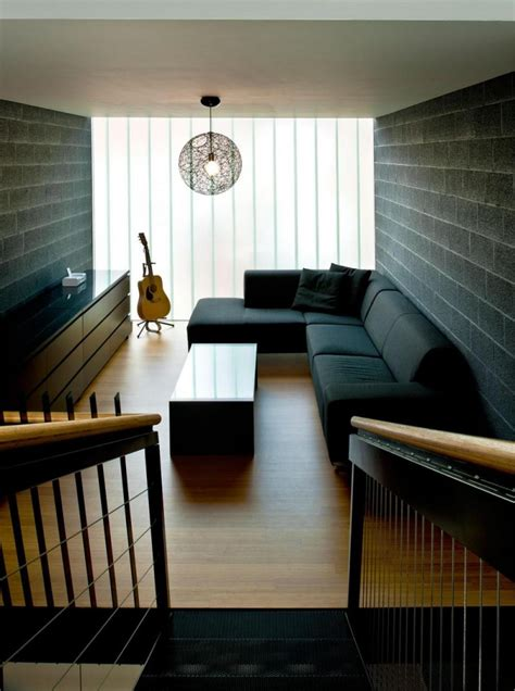 sofa for long narrow living room black sofa color with black brick wall and wooden floor