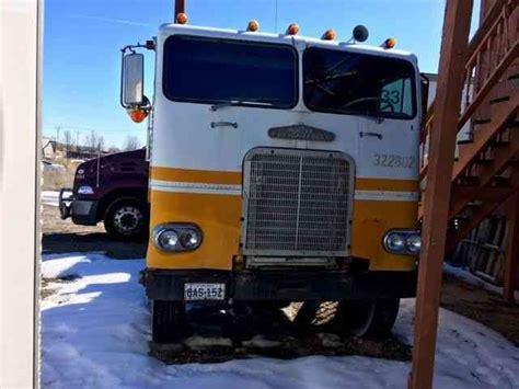 freightliner white  sleeper semi trucks